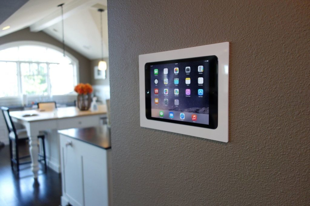 home security hub on the wall