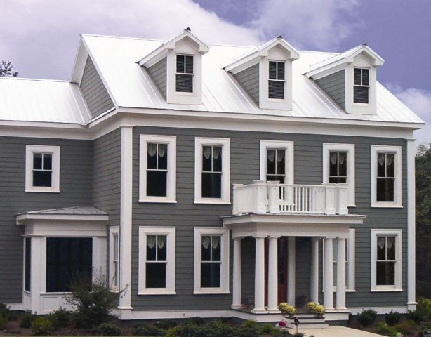 Three-story home with white roofing
