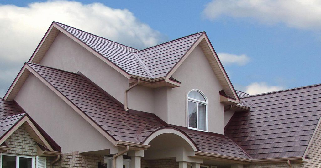 Metal roofing with dark red shingles