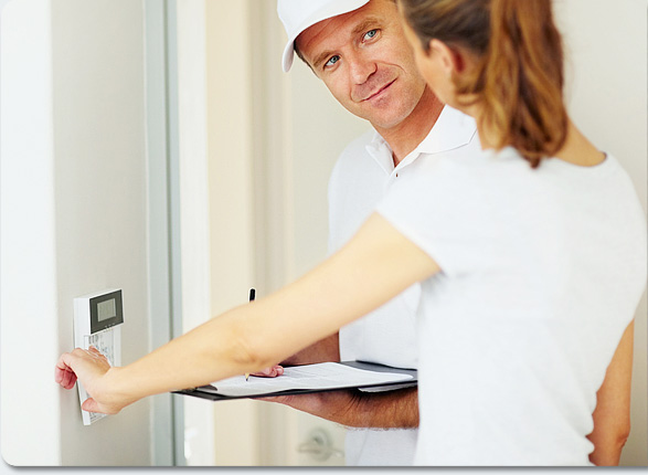 a home security professional helping install home security