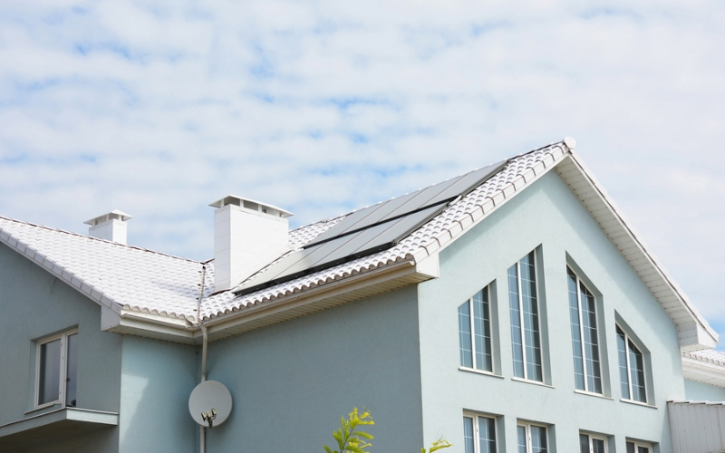 White roofing treatment with solar panel installation